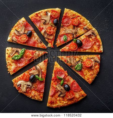 Cut Into Slices Delicious Fresh Pizza With Mushrooms And Pepperoni On A Dark Background