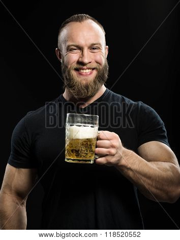Smiling Bearded Man Drinking Beer From A Beer Mug Over Black Bac