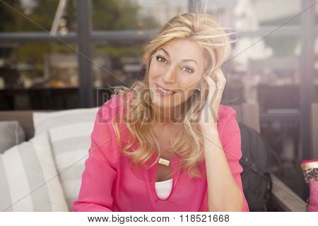 portrait of pretty middle aged woman sitting on sofa