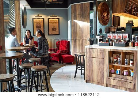 HONG KONG - JUNE 03, 2015: interior of Pacific Coffee cafe. Pacific Coffee Company is a Pacific Northwest U.S.- style coffee shop group originating from Hong Kong