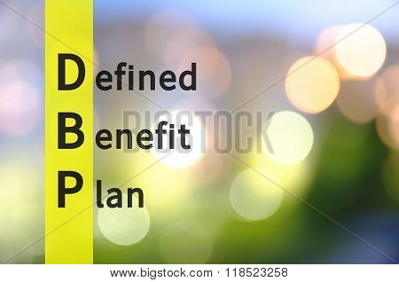 Acronym DBP as Defined Benefit Plan. The blurred lights visible in the background.
