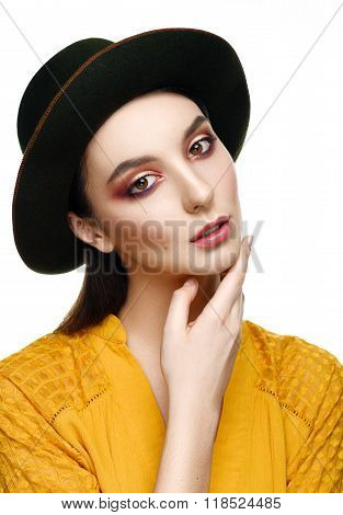 Portrait Of A Beautiful Girl In The Hat On A White Background