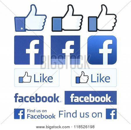 Facebook logos and thumbs up printed on white paper. Facebook is a well-known social networking