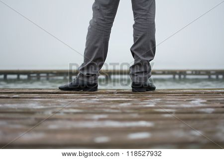 Man in elegant trousers and shoes from behind