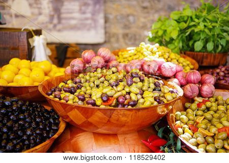 Marinated garlic and olives on provencal street market in Provence France. Selling and buying.