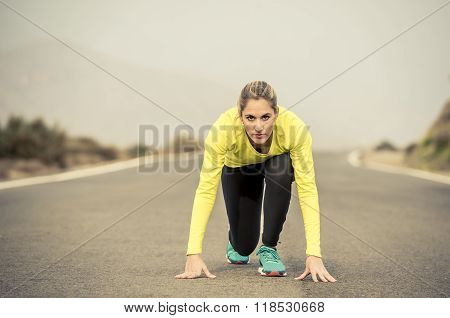 Attractive Blond Sport Woman Ready To Start Running Practice Training Race Starting On Asphalt Road
