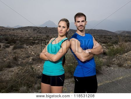 Young Sport Couple Posing Shoulder To Shoulder Looking Cool And Defiant Attitude