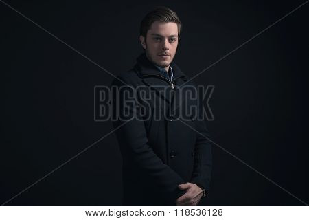 Young Man With Stubbly Beard Wearing Dark Blue Winter Jacket.