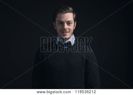 Hipster Man Wearing Dark Blue Sweater And Light Blue Shirt With Bow Tie.