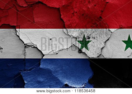 flags of Netherlands and Syria painted on cracked wall