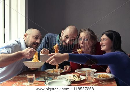 Friends eating together