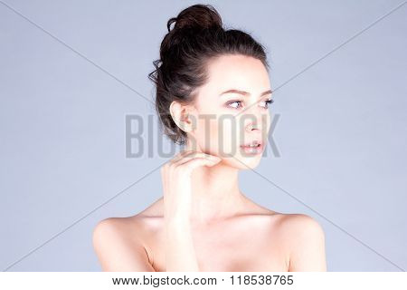 Clean and fresh face of woman. Beautiful woman with long neck touching cheek. Result facial.
