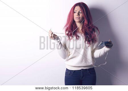 Woman Using Earphones From Smart Phone