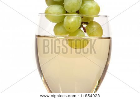Green grapes dipped into white wine
