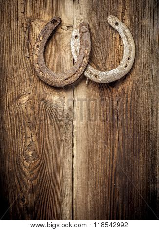 Lucky Horseshoes On Old Wall