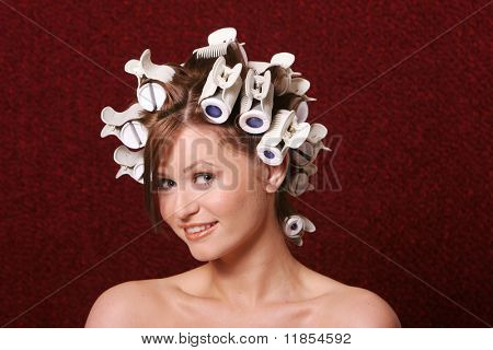 Girl with hair rollers on her hair