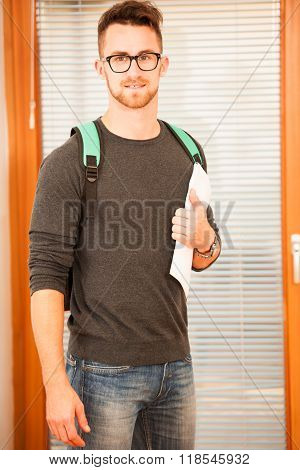 Adult man representing lifelong learning. Man with school bag showing thumb up as a gesture of happiness and joy to study.