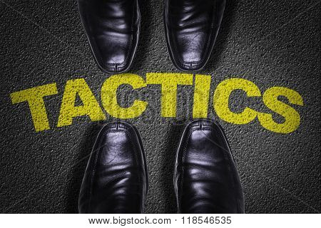 Top View of Business Shoes on the floor with the text: Tactics
