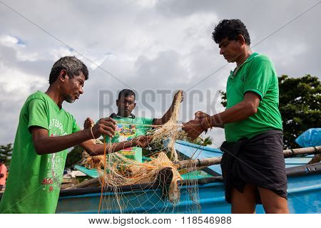Fishermans Pull Nets From The Ocean