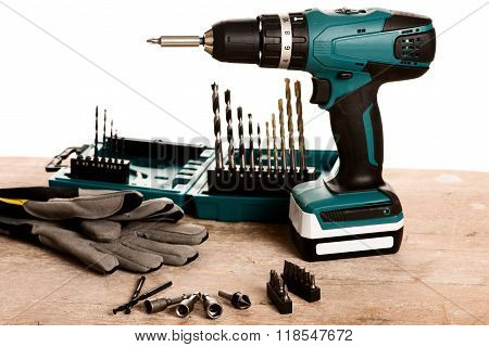 Tool Set Of Screwdriver Bits With Different Nozzles On Wooden Desk.
