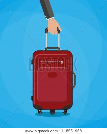 red travel bag with hand