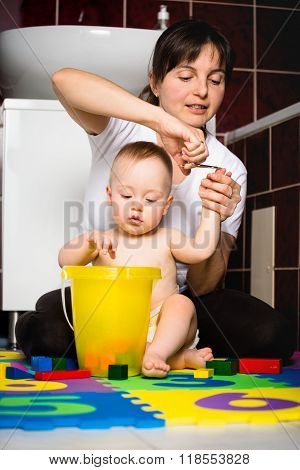 Mother and baby - cutting nails