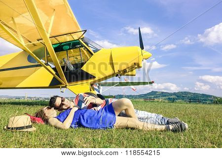 Relaxed Couple Of Lovers Having A Rest During Charter Airplane Excursion - Wanderlust Concept