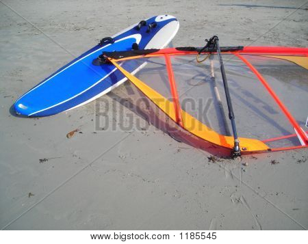 Wind Surf Board Lying On The Beach At Bintan, Indonesia