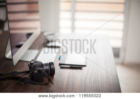 Photographer's Workspace With Bokeh