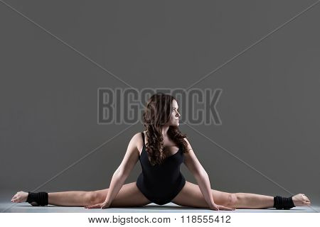 Young Woman Performing A Side Splits