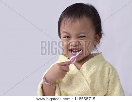 Child Girl Cleaning Teeth With Toothbrush