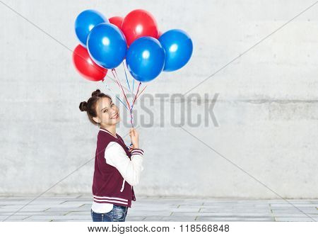 people, teens, holidays and party concept - happy smiling pretty teenage girl with helium balloons over gray urban street background