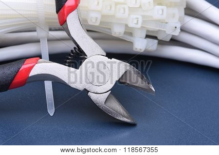 Pliers with cables and bunch of cable ties