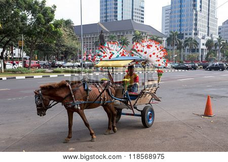 Horse Drawn Carriage In The Streets Of Jakarta