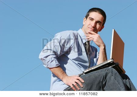 Young businessman with his laptop