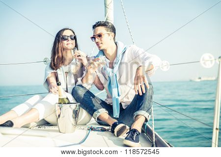 Couple Drink Champagne On A Boat