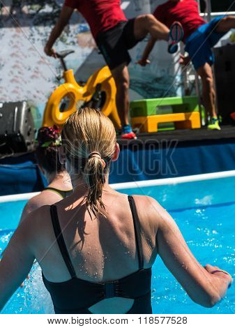Woman Doing Water Aerobics Fitness In Swimming Pool At The Leisure Centre With Instructors