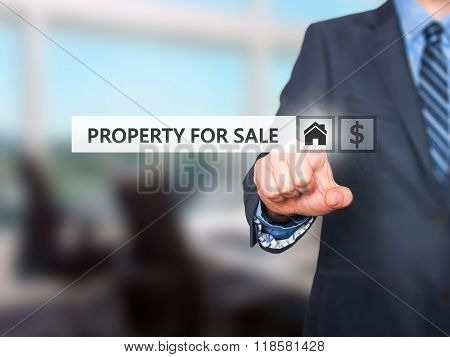 Businessman Pressing Property For Sale Button On Virtual Screens