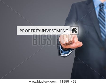 Businessman Pressing  Property Investment Button On Virtual Screens