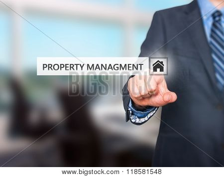 Businessman Pressing  Property Management Button On Virtual Screens