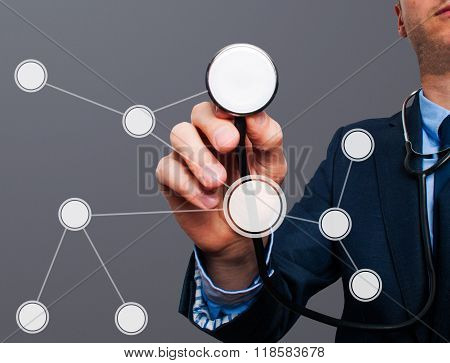 Businessman Using Stethoscope To Diagnose Business Performance Diagram