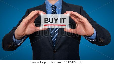 Businessman In Black Suit Holding Buy It Sign