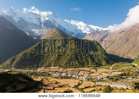Panoramic mountain view with village.