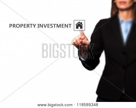 Businesswoman Pressing  Property Investment Button On Virtual Screens