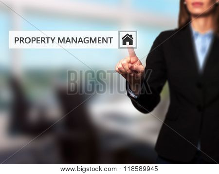 Businesswoman Pressing  Property Management Button On Virtual Screens