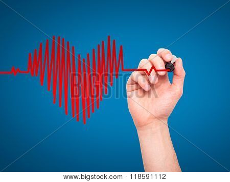 Closeup Of Hand Drawing  Heart Beat In Heart Shape With Stethoscope Isolated On Blue Background