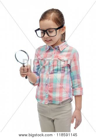 childhood, education, investigation, discovery and people concept - happy little girl in eyeglasses with magnifying glass