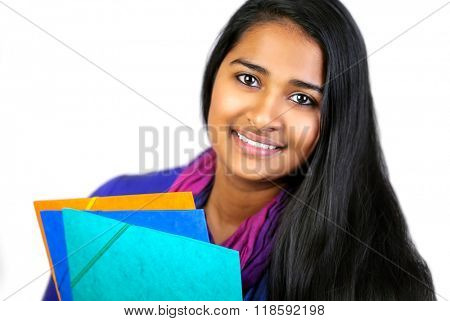 Education portrait of an pretty india woman holding notebooks on bright background