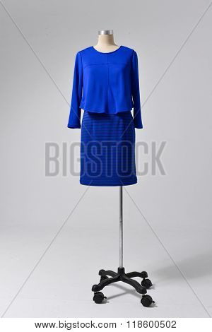 female blue clothing on dummy-gray background