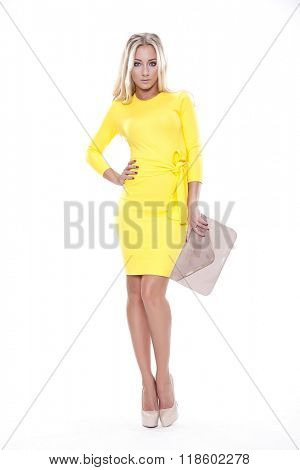 Silhouette of a beautiful young adult slim sexy and attractive sensuality pretty blonde woman in yellow elegance fashionable dress isolated on white background